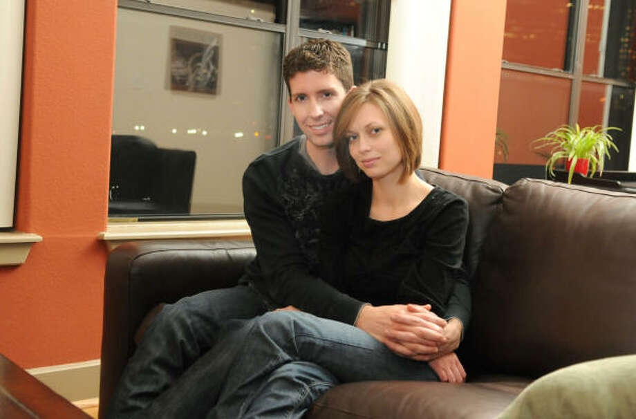 Matt and Hannah Brouwer relax on the sofa in their loft apartment in Houston. Photo: JERRY BAKER