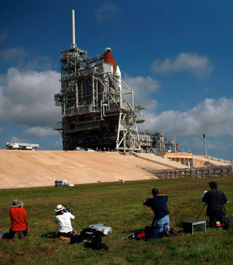 Photographers prepare remote cameras on Thursday to capture Endeavour's launch on Pad-39A in Cape Canaveral, Fla. Photo: Tom Pennington, Getty Images