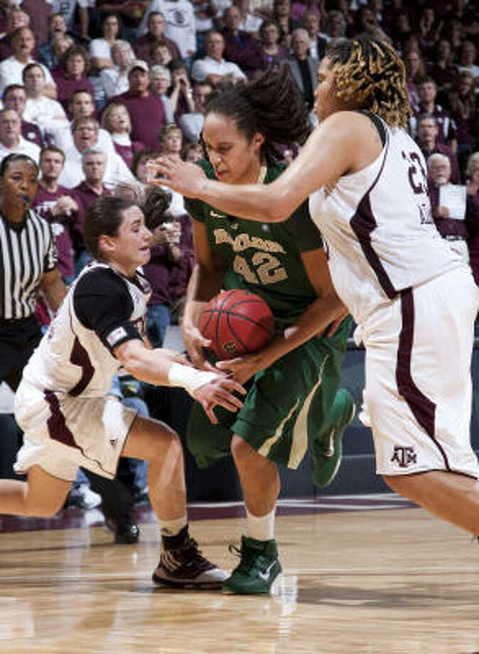 Brittney Griner, center, wasn't at her best but still came out on top of Danielle Adams in their most recent game Jan. 30. Photo: Jon Eilts, AP