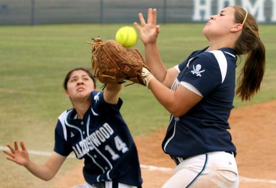 Shortstop Allie Martinez (14) almost collides with third baseman Elizabeth Coe (7). Photo: Thomas B. Shea, For The Chronicle