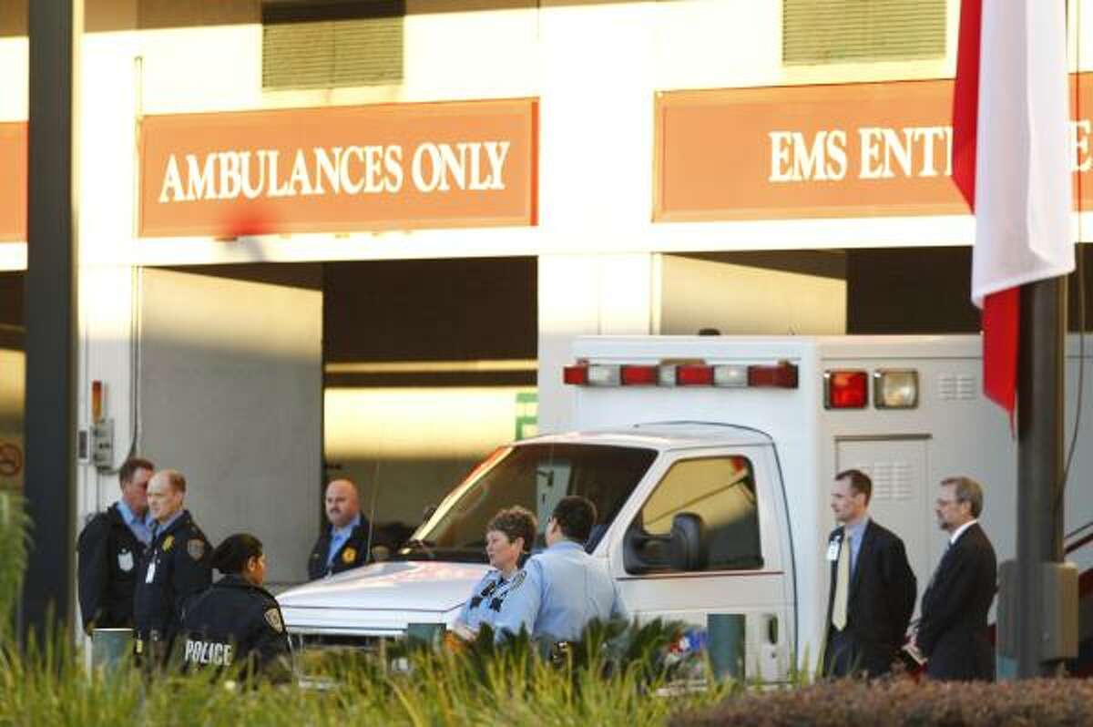 An ambulance is prepared for the congresswoman's transfer.