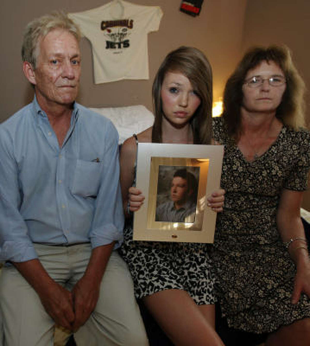The family of James Peterson - his sister Margaret, center, with parents, Tim and Bonnie - left the photos and mementos in his room after the teen died in a wreck in 2009.