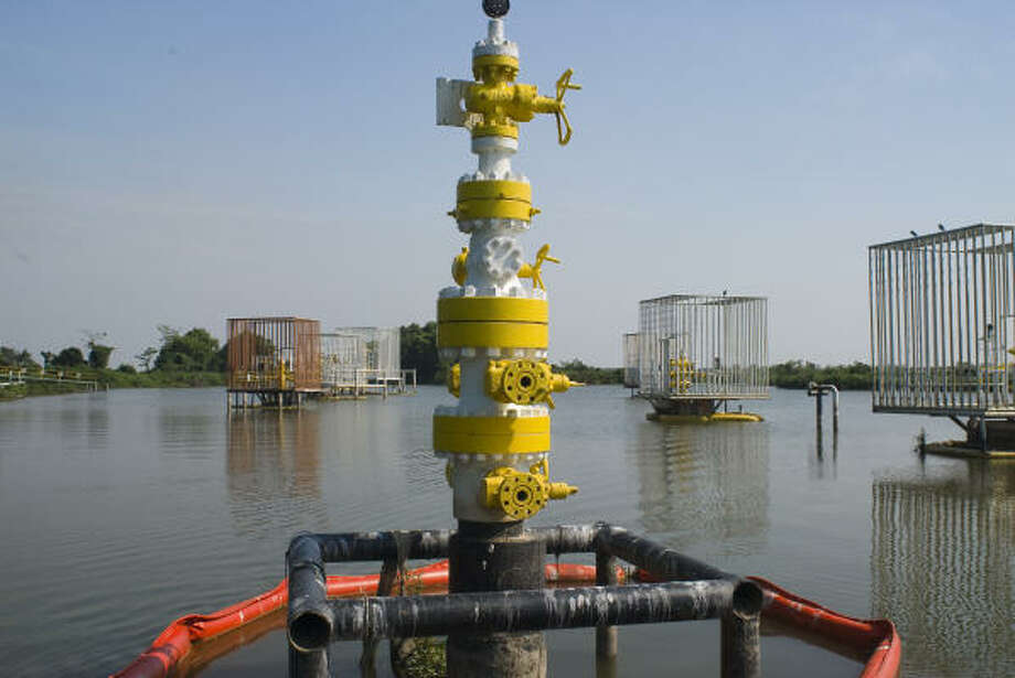 Mexico's Pemex is returning to the marshes and old fields of Tabasco as it fights to push up its production. The company, which put this cluster of wells on the Narvaez Canal in the Centla Biosphere Reserve, says new exploration and production techniques will shield the environment. Photo: Keith Dannemiller :, For The Chronicle