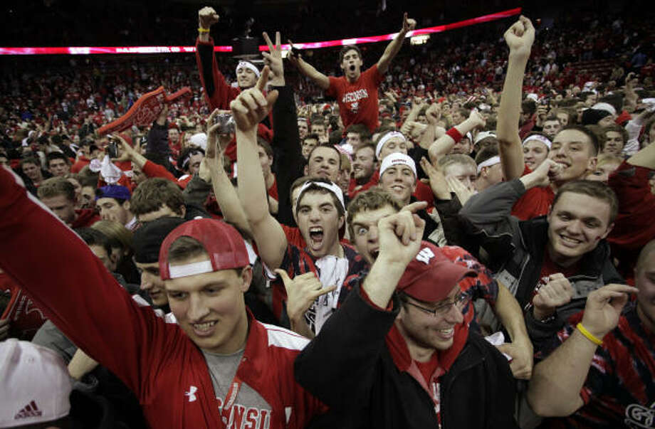 Wisconsin fans had plenty to celebrate after the Badgers beat then-undefeated and top-ranked Ohio State 71-67 this month. Photo: Morry Gash, AP