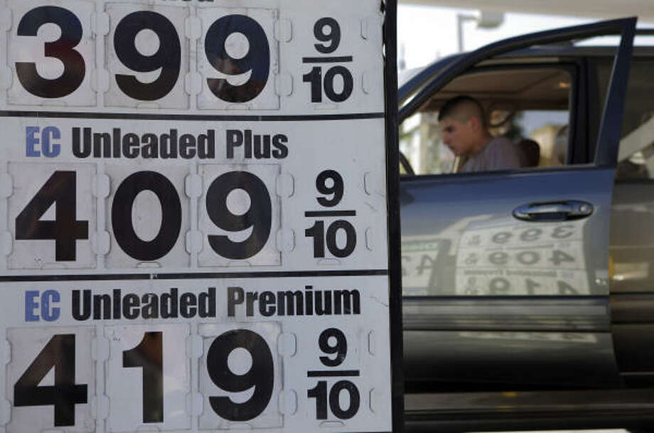 Gasoline prices are reflected on an SUV at a gas station in Los Angeles in late March. Photo: Jae C. Hong:, AP