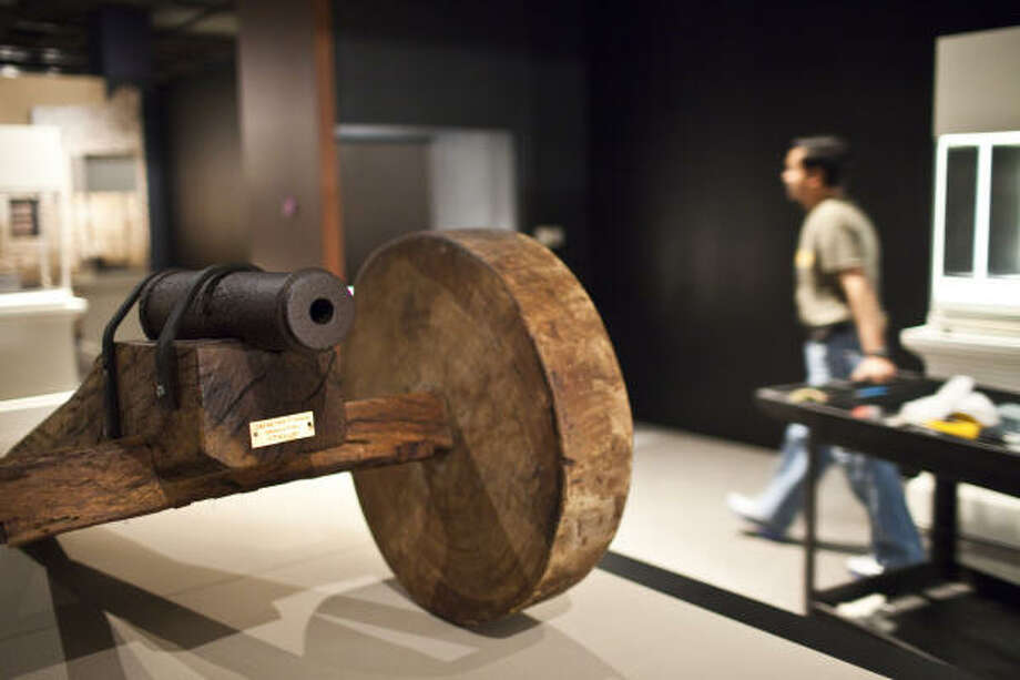A cannon that was discovered buried vertically in Gonzales will be part of the Texas history exhibit. Photo: Eric Kayne, Chronicle