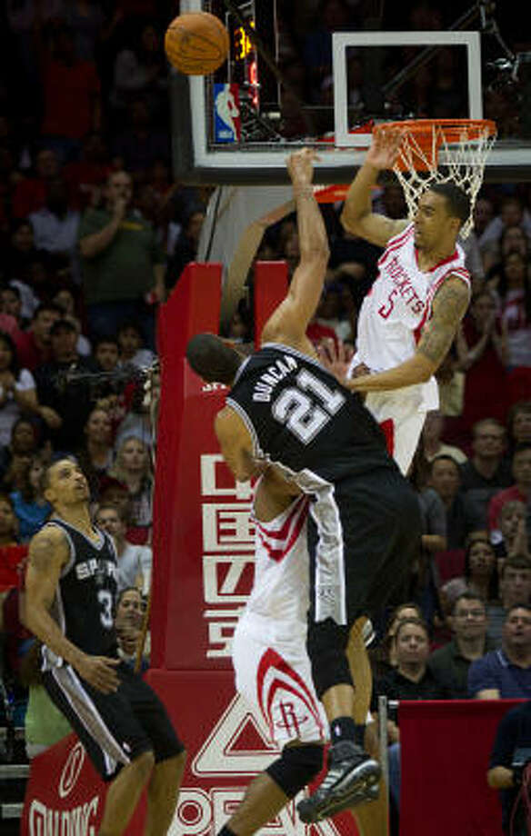 Rockets shooting guard Courtney Lee (5) fouls San Antonio Spurs center Tim Duncan (21) during the fourth quarter on Saturday night at Toyota Center. Photo: Smiley N. Pool, Chronicle