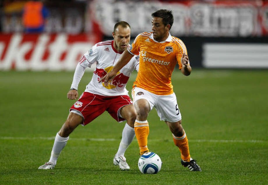 Midfielder Danny Cruz, right, is available for action after missing the Dynamo's last seven games with a knee injury. Photo: Jeff Zelevansky, Getty Images