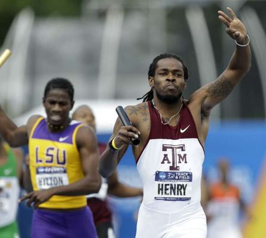 Tabarie Henry, right, and the rest of Texas A&M's 1,600-meter relay team sealed the men's third straight national championship with the victory. Photo: Charlie Neibergall, Associated Press