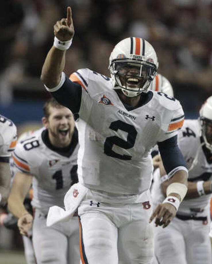 Auburn QB Cam Newton has been the center of attention throughout the season — on and off the field. Photo: Dave Martin, AP