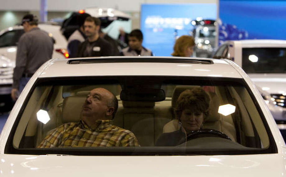 Paul and Carla Conover, of Cypress, check out a Hyundai Genesis at the Houston Auto Show. Hyundai avoided a sales decline in 2008-09. Photo: Johnny Hanson, Chronicle