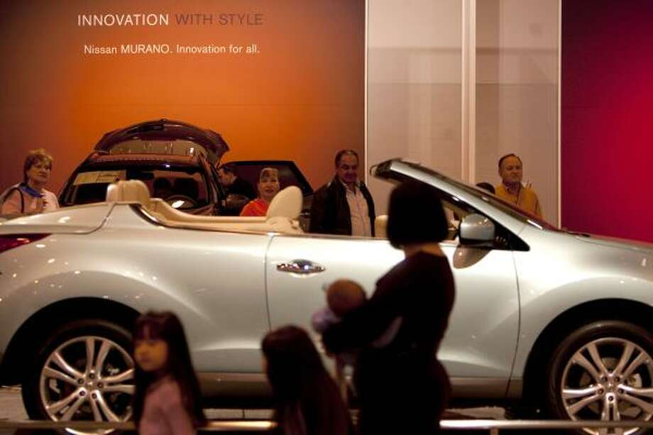 Houston Car Show visitors admire the Nissan Murano CrossCabriolet, the first convertible crossover. Photo: Johnny Hanson, Chronicle