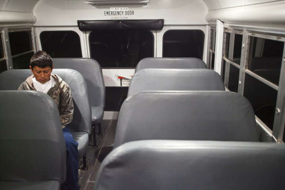 Charlie Steddun has the bus to himself during his hourlong ride to Wink Junior High School from his home in Loving County. For the district, fewer students means less funding. Photo: Albert Cesare, For The Chronicle