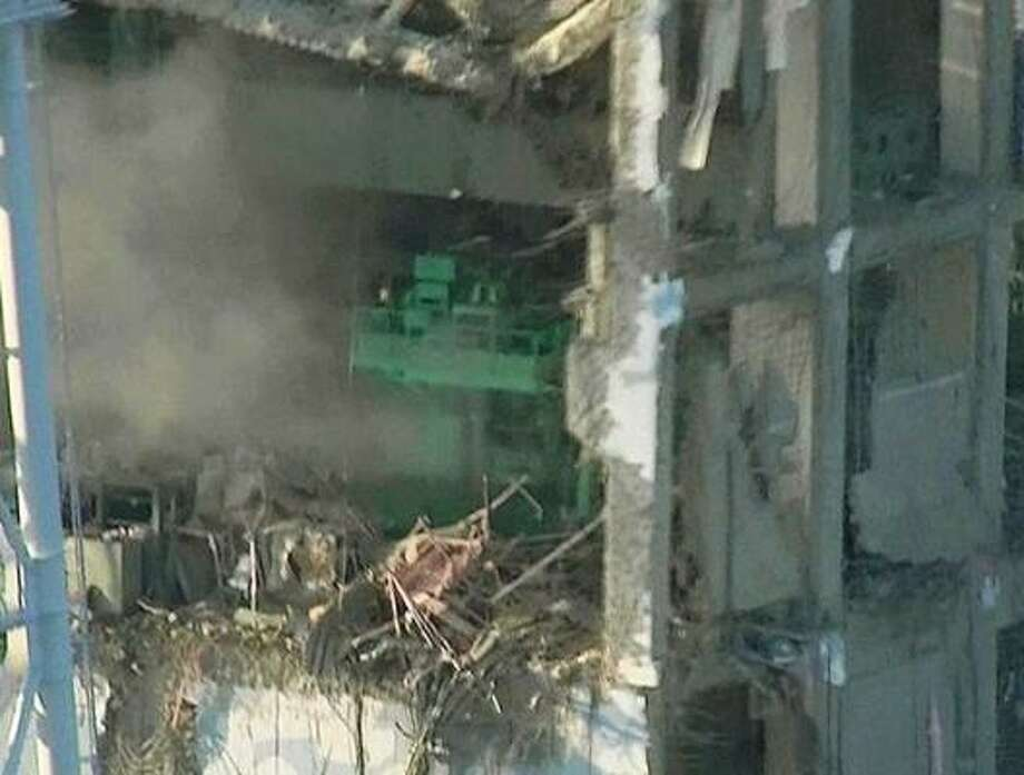 The top part of the badly damaged No. 4 unit of the Fukushima Dai-ichi nuclear power plant in Okumamachi, Fukushima Prefecture, is shown. Photo: Tokyo Electric