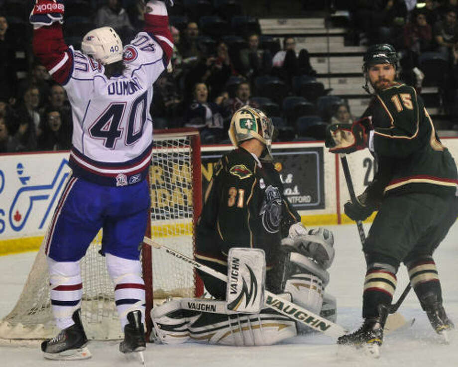 The Aeros watched the Bulldogs celebrate a win for the first time in the Western Conference finals. Photo: John Rennison, Hamilton Spectator