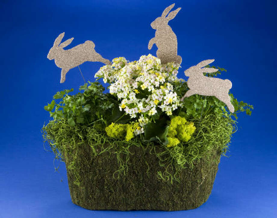 An oval moss basket is the perfect catch-all for an Easter arrangement. Photo: Brett Coomer, Houston Chronicle