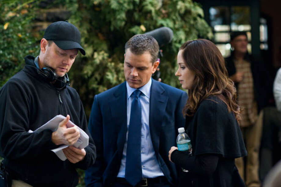 George Nolfi, left, directs Matt Damon and Emily Blunt on the set of the romantic thriller The Adjustment Bureau. Photo: Andrew Schwartz