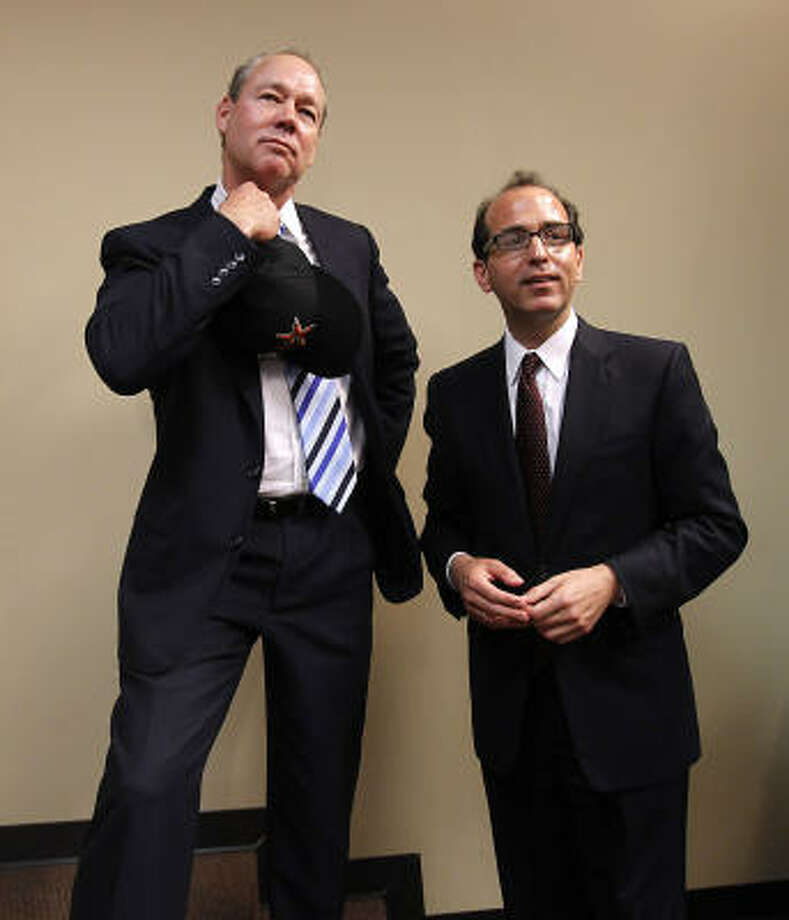 There are lessons that Jim Crane, left, and George Postolos can take from the 2011 Astros, Richard Justice writes. Photo: Karen Warren, Chronicle