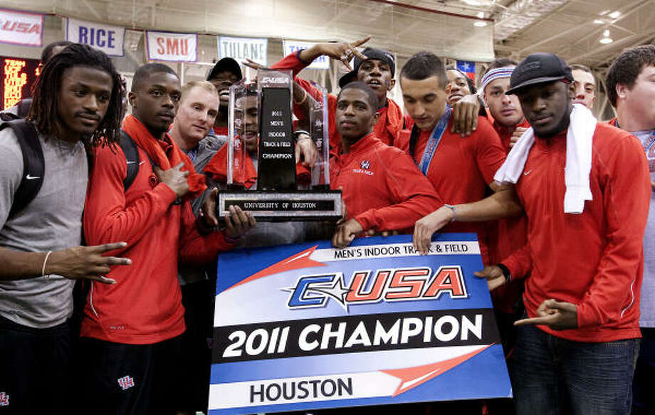 Members of the UH men's track team display their C-USA championship trophy on Saturday. Photo: Bob Levey, For The Chronicle
