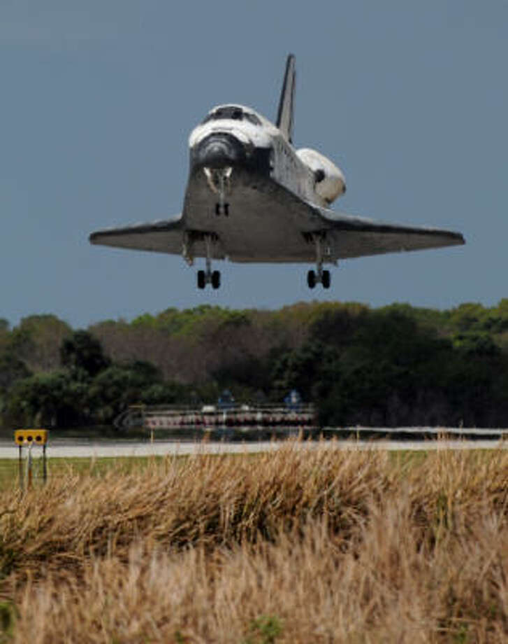 "The space shuttle lands at Kennedy Space Center in Florida. ""Houston, Discovery for the final time, wheels stop,"" said commander Steve Lindsey. Photo: STAN HONDA, AFP/Getty Images"