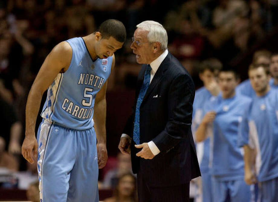 "North Carolina coach Roy Williams, right, has a mouthful of words for Kendall Marshall and most of them praiseworthy, such as ""he's the kind of point guard that does make people better."" Photo: Robert Willett, MCT"
