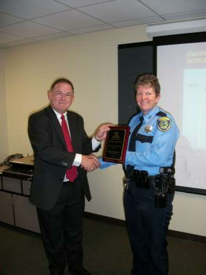 Senior officer Kate Truhan of the HPD Westside Command was recognized by Dale Konicek, chairman of the HWCOC Public Safety Committee. Photo: COURTESY PHOTO
