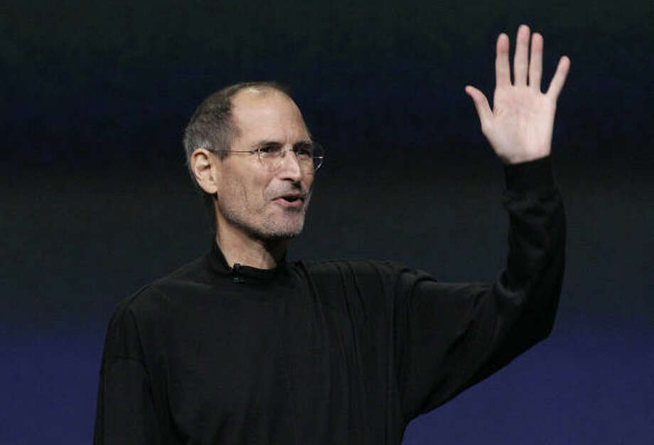 Apple Chairman and CEO Steve Jobs waves to his audience at an Apple event in San Francisco Wednesday. Photo: Jeff Chiu:, AP