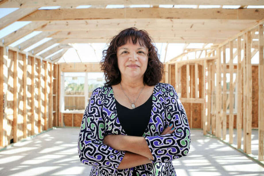 Linda Gonzales, inside her Pearland home currently under construction, says she isn't willing to budge yet on the price of her old home. Her realty company has urged her to reduce her asking price by about 10 percent. Photo: Todd Spoth, Chronicle