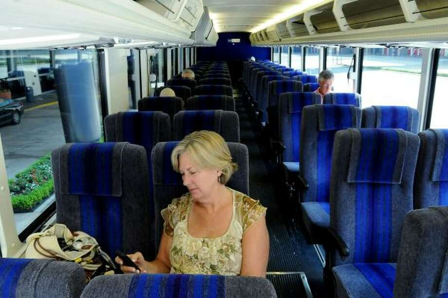 Barb Murray takes it easy while on the Metro Airport Direct bus heading to George Bush  Intercontinental Airport from downtown. A fare drop from $15 to $4.50 has helped ridership increase, but the daily service costs big bucks to run. Photo: Dave Rossman, For The Chronicle
