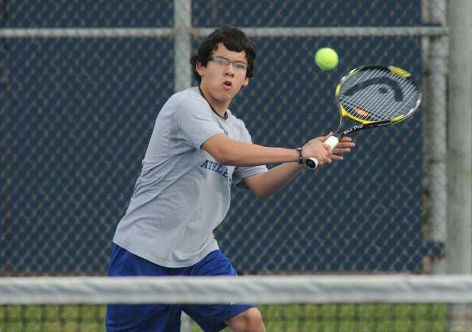 Ricardo Soliz, 13, a 7th grader at Atascocita Middle School, volleys with classmate Drew Chamberlain on the schools newly improved tennis courts. Photo by Jerry Baker Photo: Jerry Baker, For The Chronicle