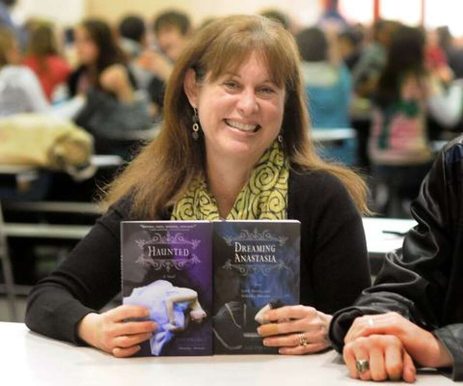 DAVID HOPPER: FOR THE CHRONICLE READY FOR READING: Joy Preble holds a copy of her new book Haunted, which is the second book in her Dreaming Anastasia trilogy. Photo: David Hopper, For The Chronicle