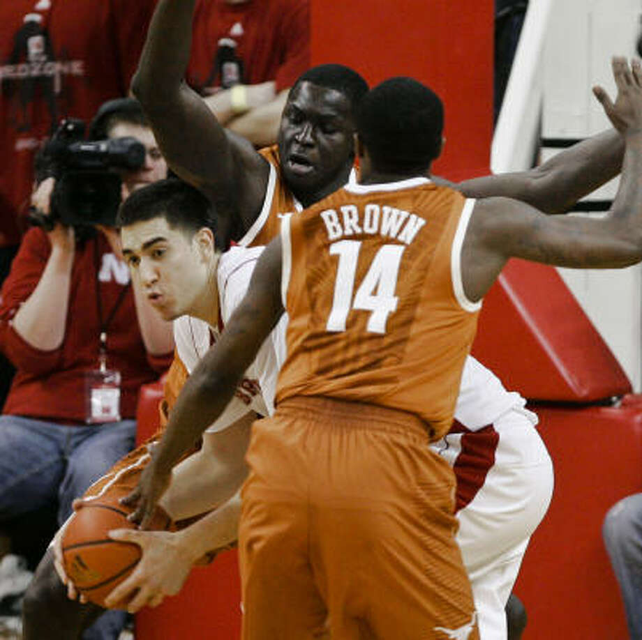 Texas' Alexis Wangmene, rear, and J'Covan Brown look to trap Nebraska's Jorge Brian Diaz on Saturday. Photo: Nati Harnik, AP