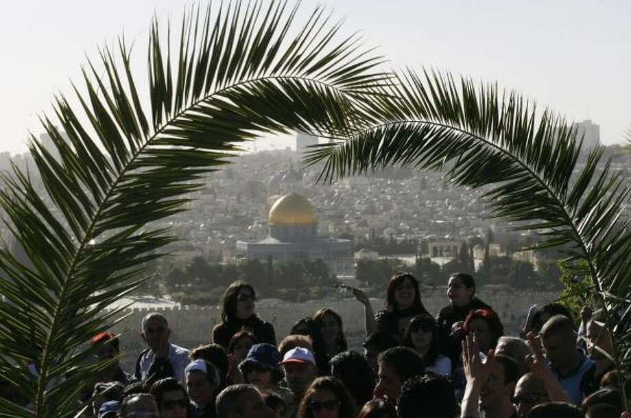 Each year, Christians descend the Mount of Olives holding palm fronds during the traditional Palm Sunday procession in Jerusalem. Photo: ED OU, ASSOCIATED PRESS FILE