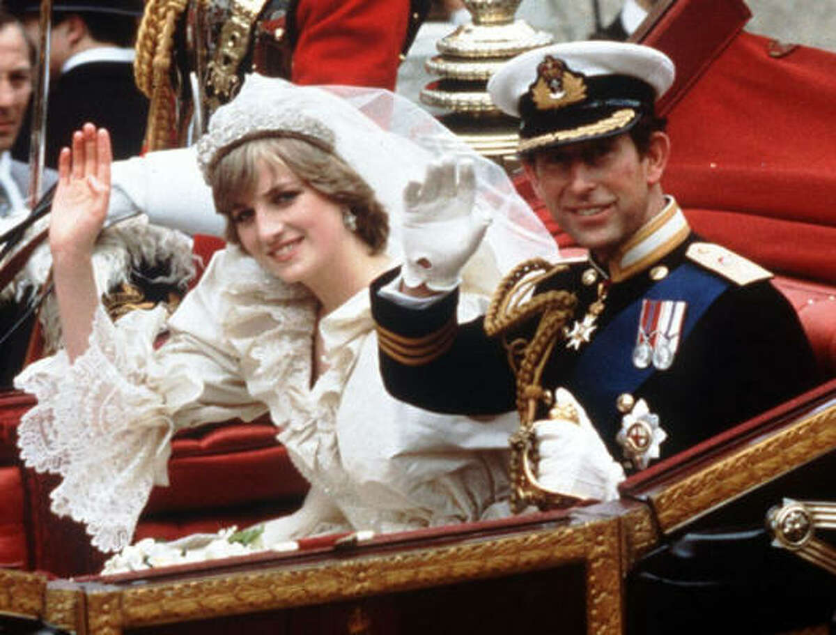 The Princess and Prince of Wales wave from their carriage on their wedding day in London, in this July 29, 1981.