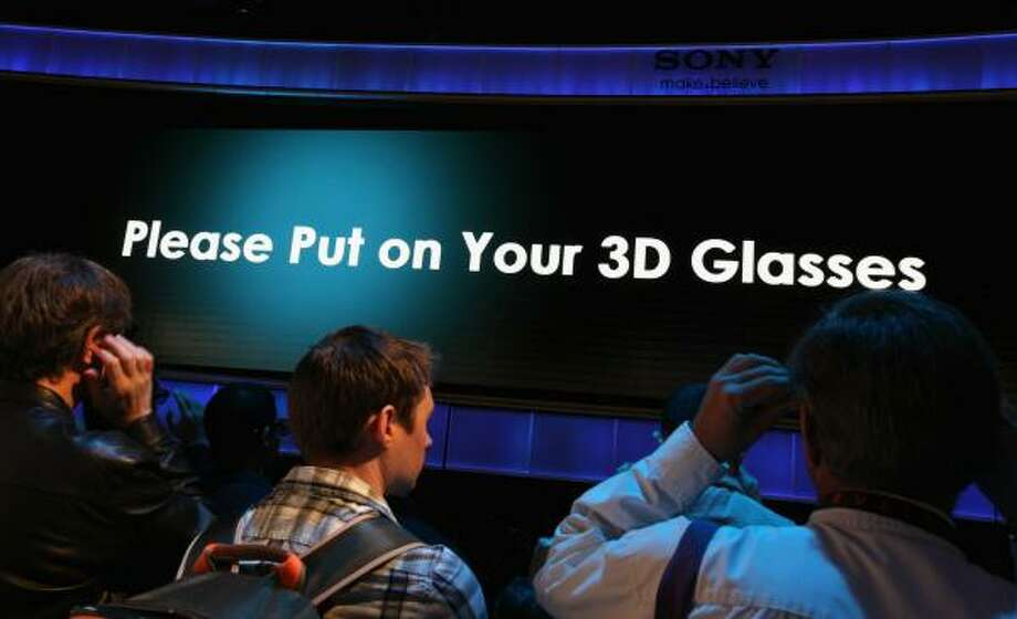 CES attendees prepare to watch a 3-D presentation in the Sony booth at the Las Vegas  trade show. Photo: Justin Sullivan:, Getty Images