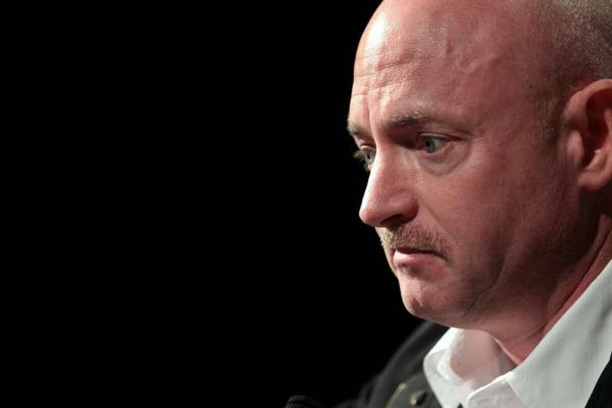 Mark Kelly, husband of U.S. Rep. Gabrielle Giffords (D-AZ), listens to a question during a press conference at the University Medical Center on Jan. 20, 2011 in Tucson.