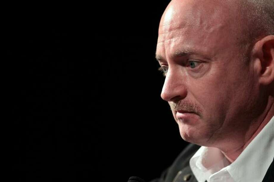 Mark Kelly, husband of U.S. Rep. Gabrielle Giffords (D-AZ), listens to a question during a press conference at the University Medical Center on Jan. 20, 2011 in Tucson. Photo: John Moore, Getty Images