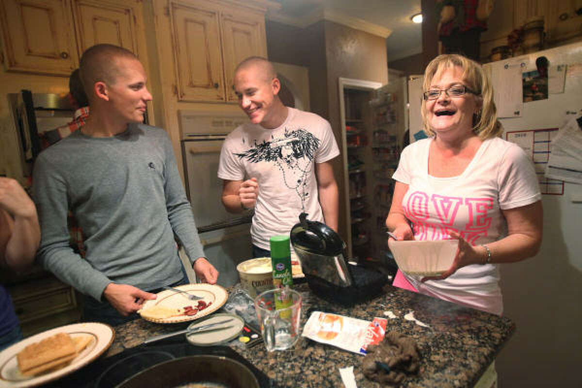 Debra Koym-Kirton says she is coming to terms with the deployment of both of her sons, Cody, left, and Bobby Henrichsen, who visited home recently before their mission to Afghanistan.