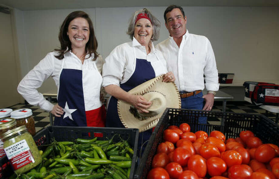 Audrey Skelton, left, and her parents, Peggy and Rick Wright, work in the industrial kitchen for their salsa company, Wrights of Texas. Photo: Melissa Phillip :, Chronicle
