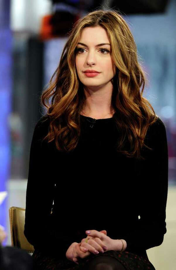 Anne Hathaway. The actress was cast as the unintentionally pregnant entertainment reporter, but backed out because she had problems with the plan to use real childbirth footage, according to director Judd Apatow.