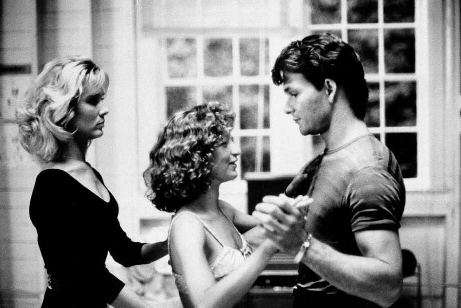 "Patrick Swayze, right, landed the role of Johnny Castle in ""Dirty Dancing,"" but he had to make up with costar Jennifer Grey first - the two had starred in ""Red Dawn"" together, and hadn't gotten along. The other first choices to play the blue-collar dance instructor were... Photo: Anonymous, HO / 1988 AP"