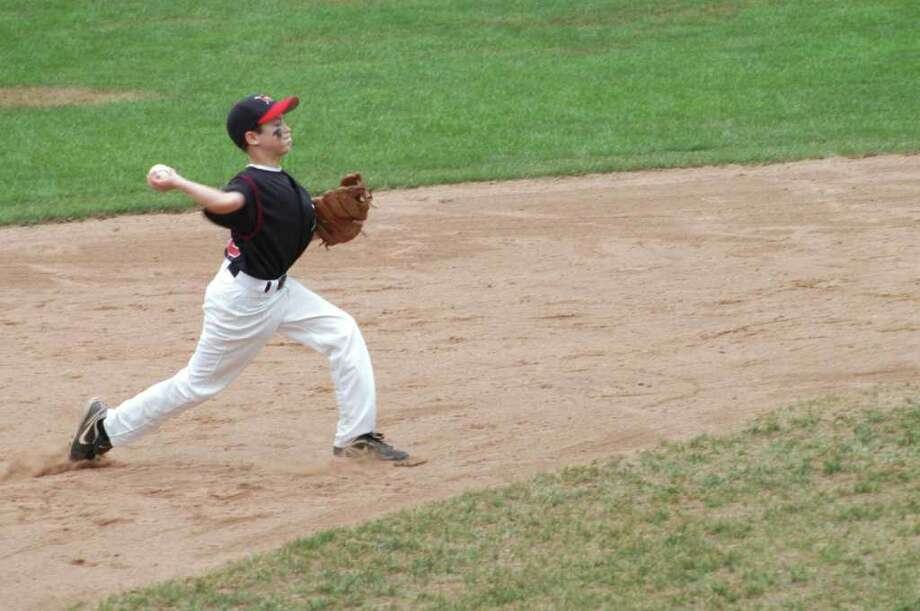 New Canaan shortstop Dillon Abate prepares to make a throw to first at Glander Field in Newtown on Saturday. Newtown defeated New Canaan 12-11 in extra innings in the Cal Ripken Baseball U11 State Championship game. Photo: Contributed Photo