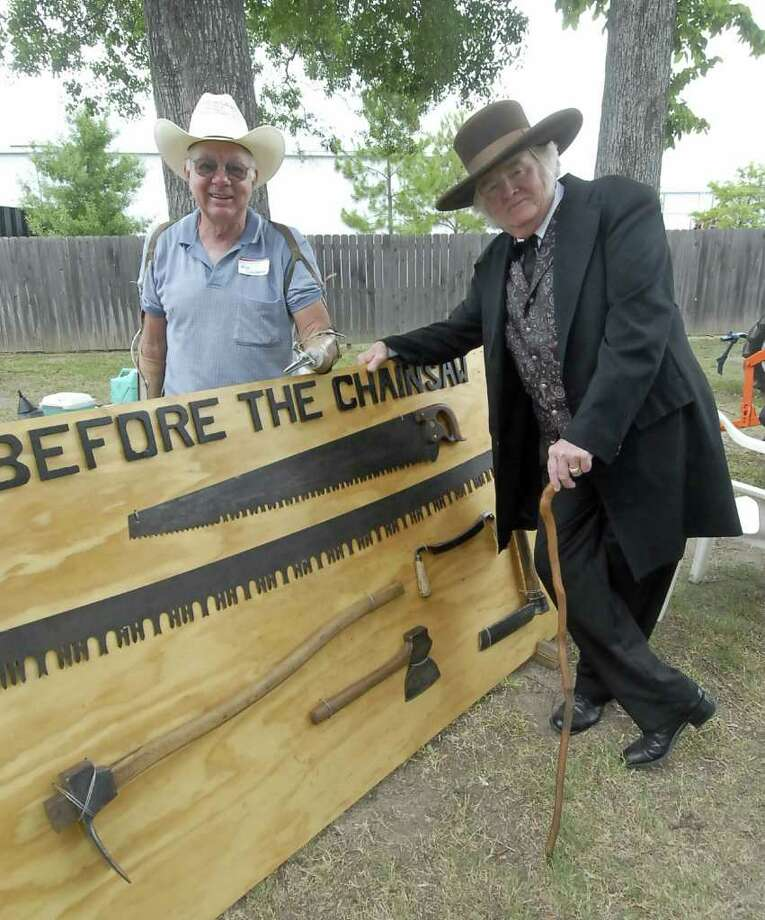 "Bill Schlobohm and Charlie Fogarty (costumed as ""Sam Houston"") look over an exhibit of hand-held saws during the Cypress Historical Society third annual old-fashioned picnic at Cypress Top Historic Park Saturday 7/09/11. Photo by Tony Bullard. Photo: Tony Bullard / Credit: for the Chronicle"