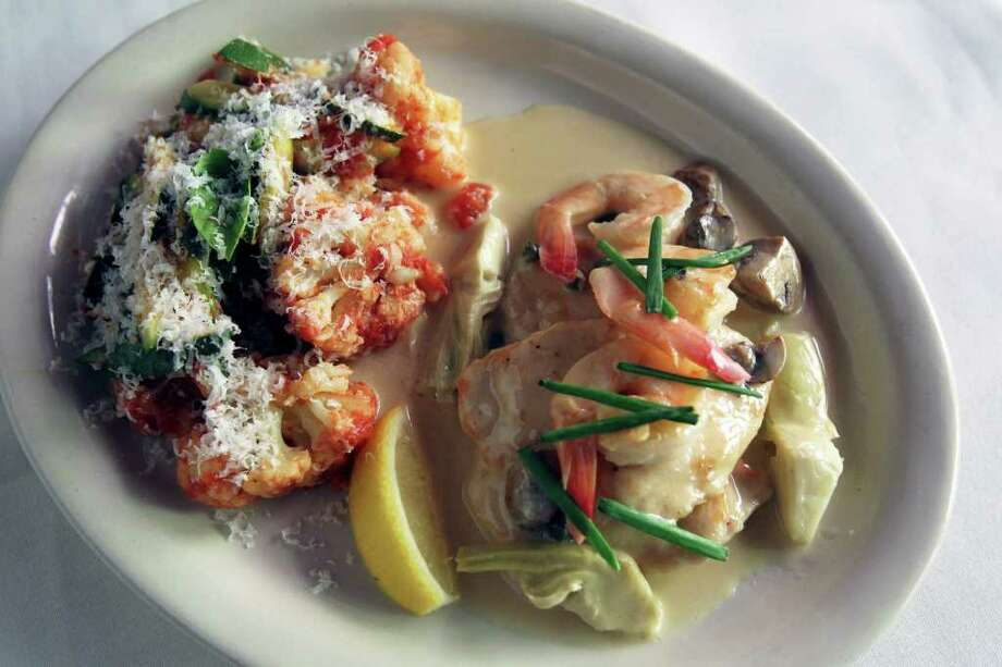 The shrimp and chicken picatta at Bella . . . On the River is among comfort favorites on the menu. Bella is in the space of the former Dolores Del Rio. Photo: TOM REEL, Tom Reel/Staff / © 2011 San Antonio Express-News