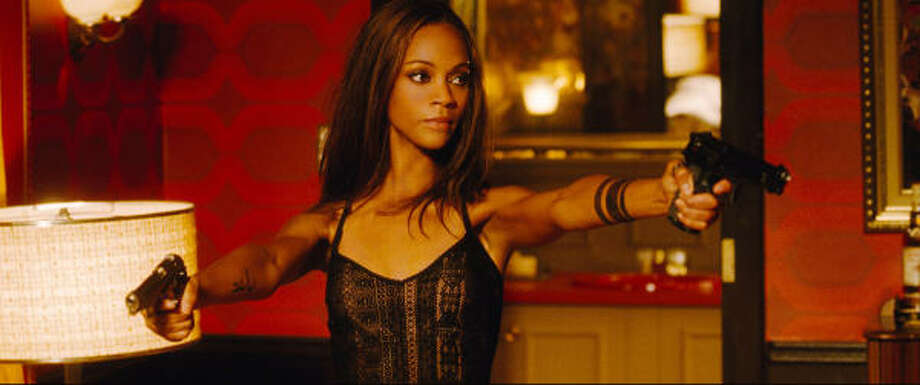 Zoë Saldana stars as Aisha, a mysterious special forces operative, in the action thriller The Losers. Photo: Warner Bros.