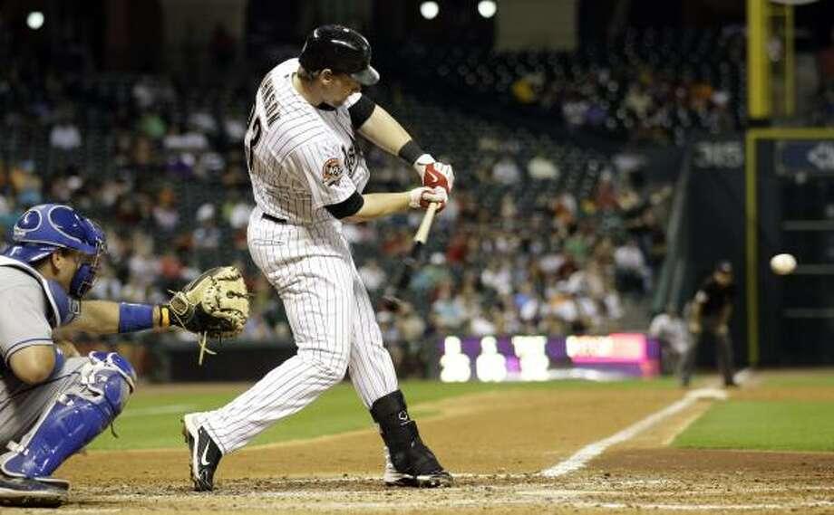 Astros third baseman Chris Johnson hits a three-run homer in the sixth inning against the Dodgers on Thursday night. Photo: David J. Phillip, AP