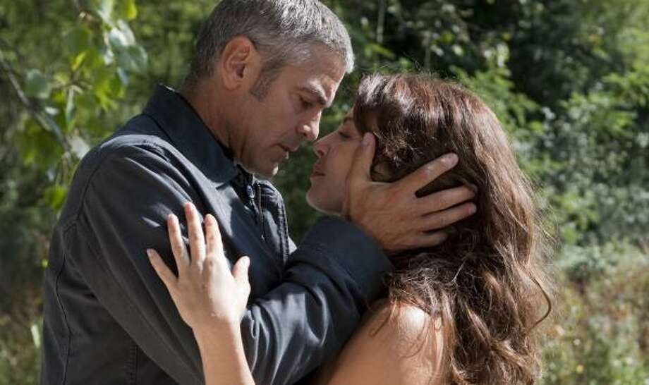 George Clooney and Violante Placido star in The American. Photo: Giles Keyte, Focus Features