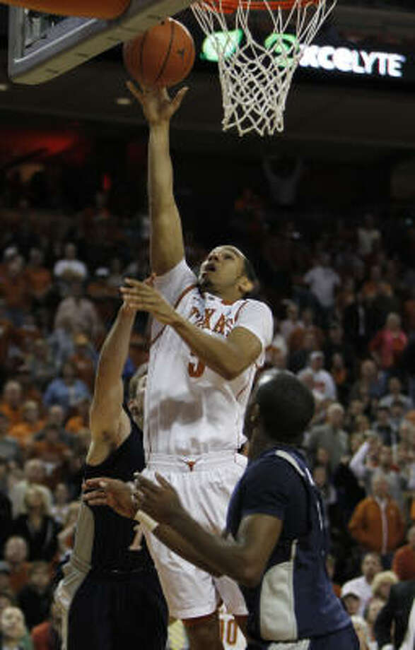 Texas' Cory Joseph led all scorers with 14 points. Photo: Erich Schlegel, AP