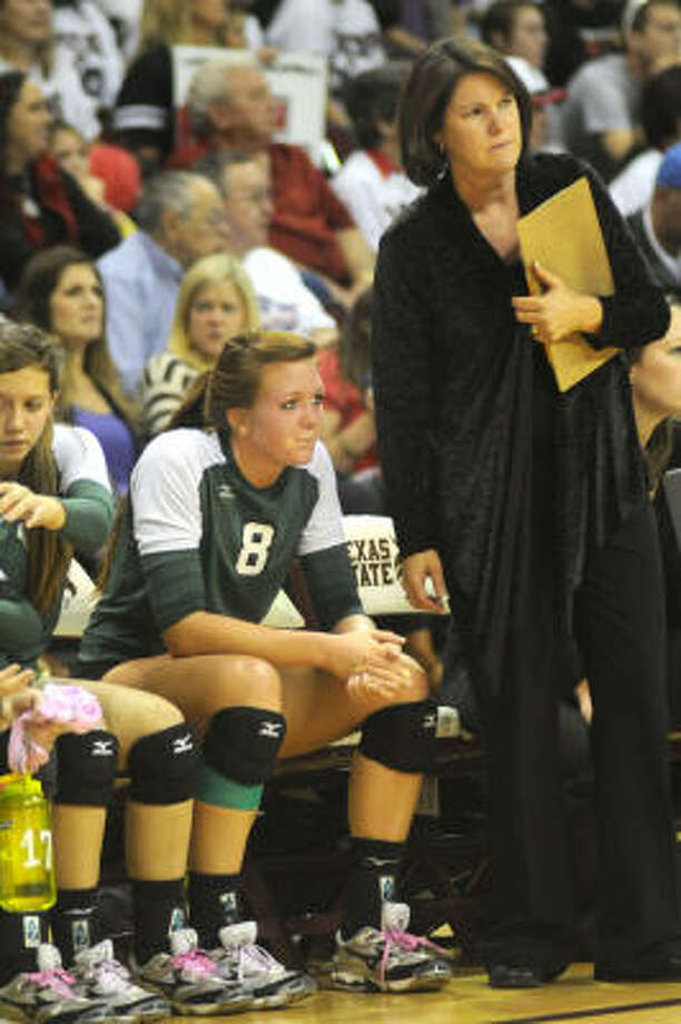 Brenham senior Caroline Young (8) and head coach Debbie Yeager couldn't overcome Lake Travis Saturday afternoon in San Marcos. Photo: Jerry Baker, For The Chronicle