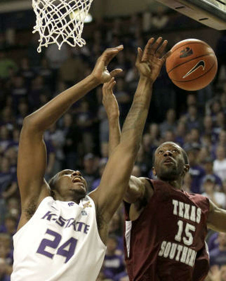 Texas Southern guard Boune Abdallah (15) and Kansas State forward Curtis Kelly battle for a rebound during the first half on Friday night. Photo: Charlie Riedel, AP